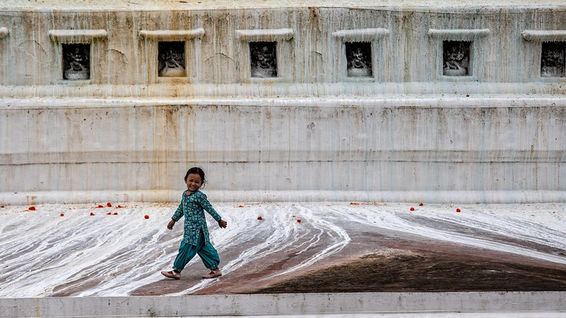 A Young Girl Wanders Around On The Boudha Stupa, Kathmandu, Nepal