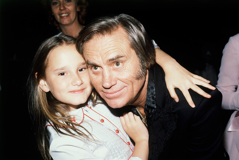 ". In this April 30, 1981 file photo, Country singer George Jones, winner of top male vocalist award at the Academy of Country Music Awards, poses with his daughter Georgette, in Los Angeles, Calif.   Jones, the peerless, hard-living country singer who recorded dozens of hits about good times and regrets and peaked with the heartbreaking classic ""He Stopped Loving Her Today,\"" has died. He was 81. Jones died Friday, April 26, 2013 at Vanderbilt University Medical Center in Nashville after being hospitalized with fever and irregular blood pressure, according to his publicist Kirt Webster.(AP Photo/Nick Ut, file)"