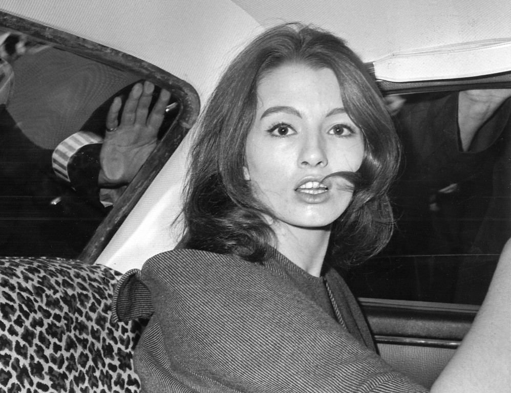 . FILE - in this file photo dated  July 22, 1963 Christine Keeler, a principal witnesses in the vice charges case against osteopath Dr. Stephen Ward.  The model at centre of Profumo Affair, a scandal that rocked the political establishment and forced cabinet minister to resign, has died Tuesday Dec. 5, 2017, according to a statement issued by her family.  (AP Photo/FILE)