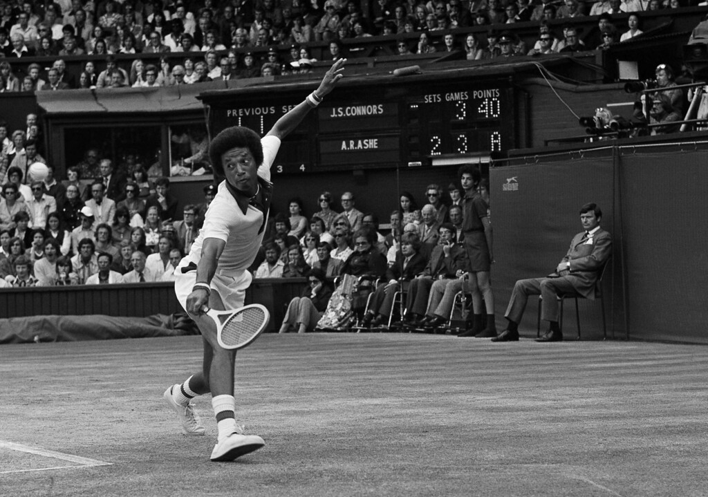 . Arthur Ashe of Richmond, Virginia, the first Black tennis player to win the men\'s singles tittle at Wimbledon, makes a backhand return when beating Jimmy Connors, of Believille, Illinois, on the Centre Court of the All England Lawn Tennis Club on July 5, 1975 at Wimbledon, near London.   Ashe won 6-1, 6-1, 5-7, 6-4. (AP photo)