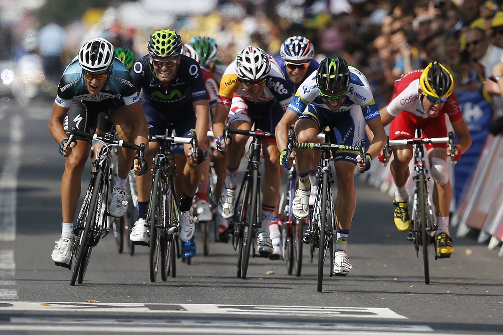 . Italy\'s Matteo Trentin (L) sprints before winning at the end of the191 km fourteenth stage of the 100th edition of the Tour de France cycling race on July 13, 2013 between Saint-Pourcain-sur-Sioule and Lyon, central eastern France. JEFF PACHOUD/AFP/Getty Images