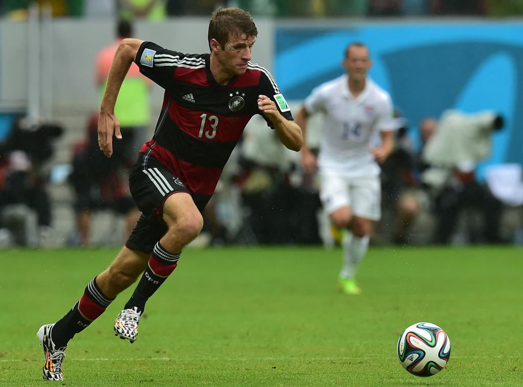 . Germany\'s forward Thomas Mueller runs with the ball during a Group G football match between US and Germany at the Pernambuco Arena in Recife during the 2014 FIFA World Cup on June 26, 2014. NELSON ALMEIDA/AFP/Getty Images