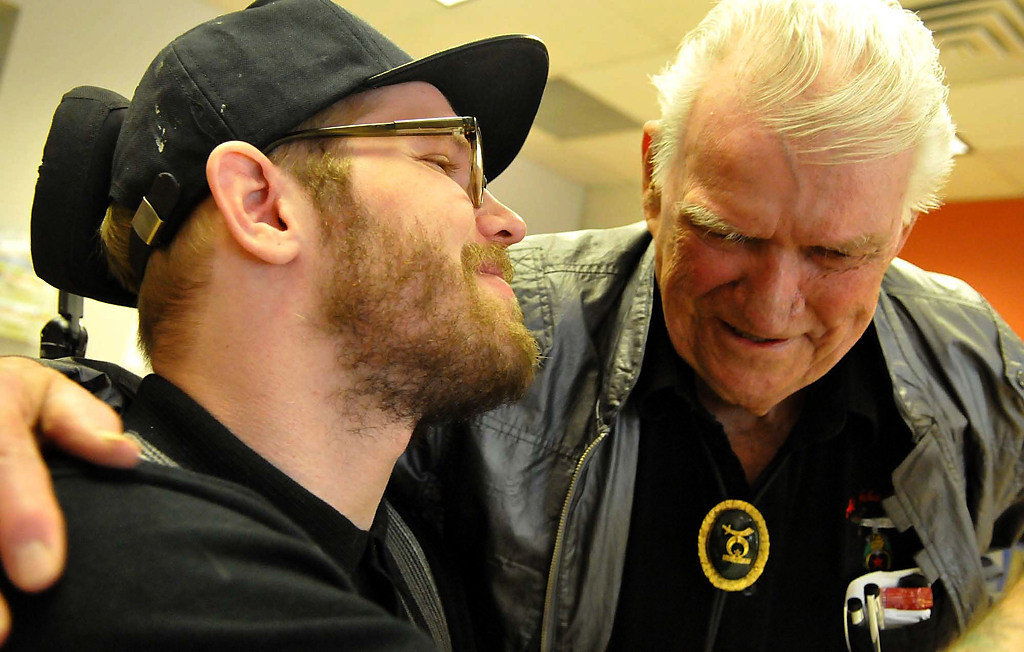 . Zack Mohs whispers to Ken Krasselt at Courage Center in Golden Valley. Krasselt was the first person to help Mohs after he was severely injured in a hit-and-run in Alaska. Months later, Krasselt flew to Minnesota to see Mohs. (Pioneer Press: John Doman)