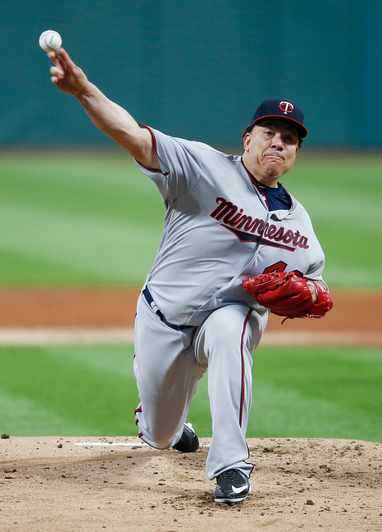 . Minnesota Twins starting pitcher Bartolo Colon delivers against the Cleveland Indians during the first inning in a baseball game, Tuesday, Sept. 26, 2017, in Cleveland. (AP Photo/Ron Schwane)