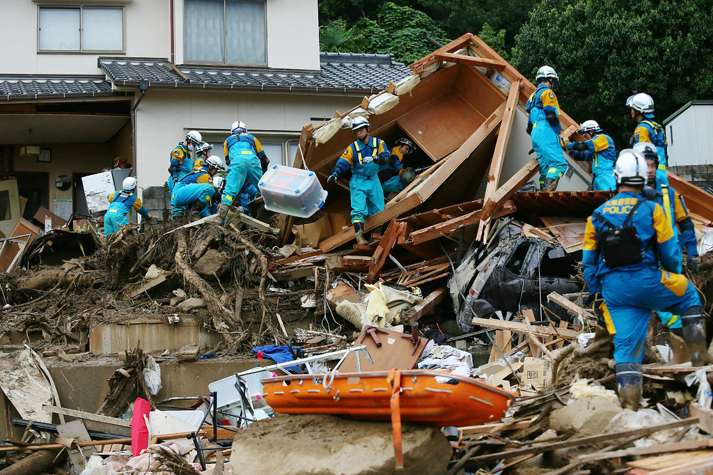 . Police officers search for missing people after a landslide hit a residential area in Hiroshima, western Japan on August 20, 2014. AFP PHOTO / JIJI PRESS  JIJI PRESS/AFP/Getty Images