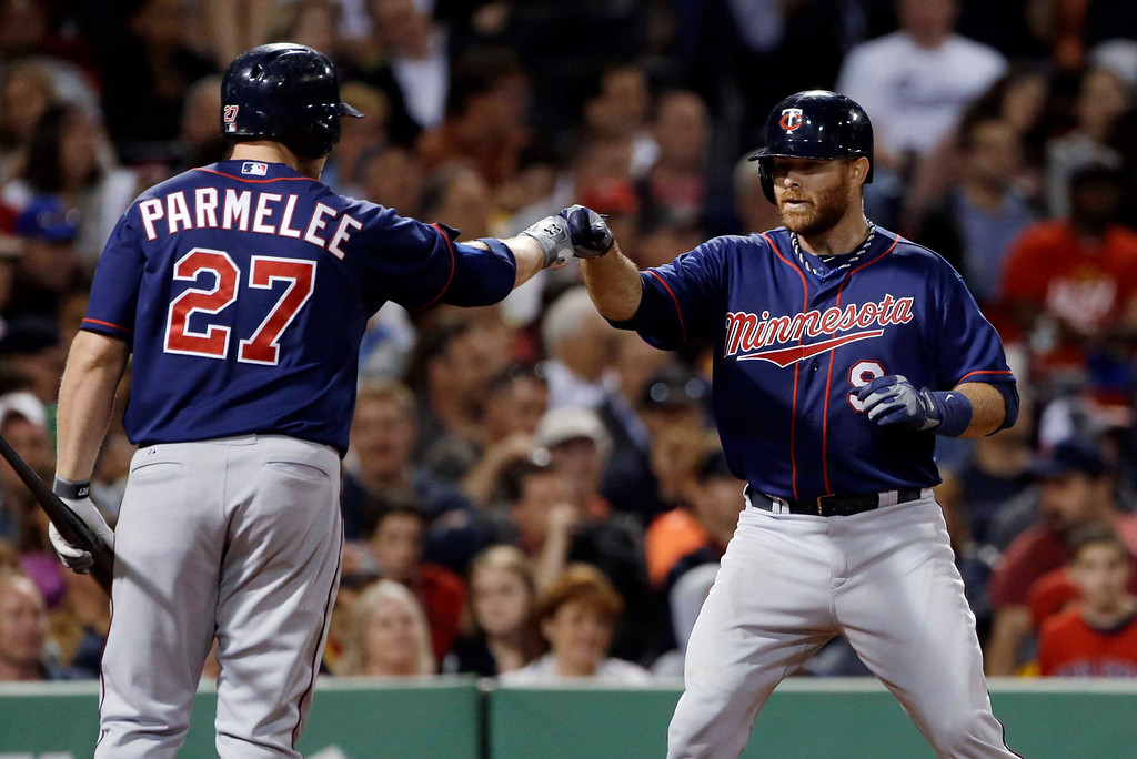 . Minnesota Twins designated hitter Ryan Doumit (9) celebrates his solo home run with Chris Parmelee (27) during the seventh inning of a baseball game against the Boston Red Sox at Fenway Park in Boston, Tuesday, May 7, 2013. (AP Photo/Elise Amendola)