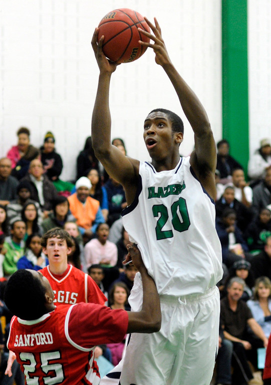 . Blazers center De\'Ron Davis (20) looked to the basket in the first half. The Overland High School boy\'s basketball team defeated Regis Jesuit 80-66 Tuesday night, December 11, 2012.  Karl Gehring/The Denver Post