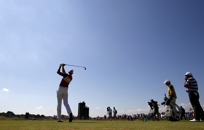 . Sweden\'s Henrik Stenson (L) watches his shot from the 9th tee during his first round on the opening day of the 2014 British Open Golf Championship at Royal Liverpool Golf Course in Hoylake, north west England on July 17, 2014. (PETER MUHLY/AFP/Getty Images)