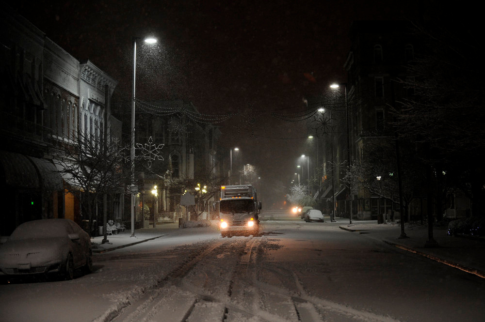 Description of . A city waste management truck drives on Broadway in Paducah, Ky. while collecting trash downtown during a winter storm Wednesday, Dec. 26, 2012 (AP Photo/Stephen Lance Dennee)