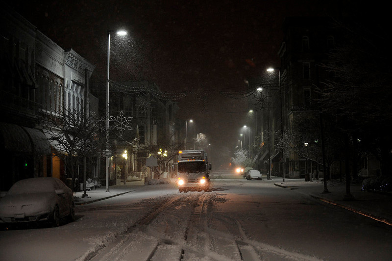 . A city waste management truck drives on Broadway in Paducah, Ky. while collecting trash downtown during a winter storm Wednesday, Dec. 26, 2012 (AP Photo/Stephen Lance Dennee)