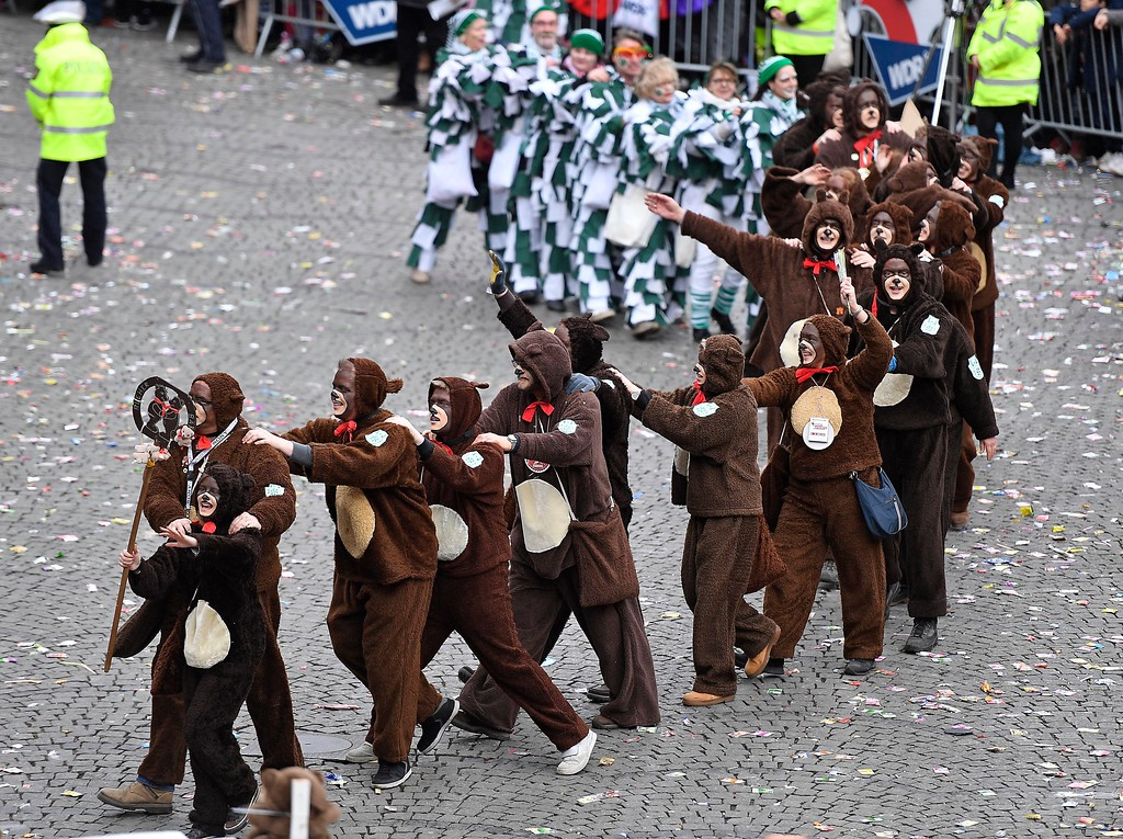 . Revellers dance at the traditional carnival parade in Duesseldorf, Germany,  Monday, Feb. 27, 2017. The foolish street spectacles in the carnival centers of Duesseldorf, Mainz and Cologne, watched by hundreds of thousands of people, are the highlights in Germany\'s carnival season on Rosemonday. (AP Photo/Martin Meissner)