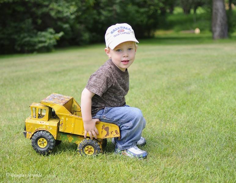 2010   Caden sitting in his Tonka Truck