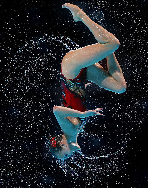 . A Ukraine swimmer competes in the Synchronized Swimming Duet Technical preliminary round on day two of the 15th FINA World Championships at Palau Sant Jordi on July 21, 2013 in Barcelona, Spain.  (Photo by Clive Rose/Getty Images)