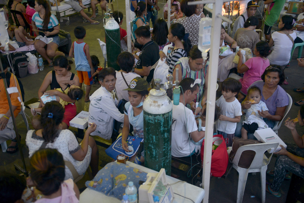 . People are treated at a temporary shelter  following a 7.1-magnitude quake in Cebu on October 15, 2013.  AFP PHOTO / Jay  DIRECTO/AFP/Getty Images