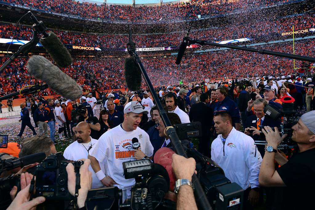 . Denver Broncos quarterback Peyton Manning (18) is interviewed on the field after the Broncos won the AFC Championship game.  The Denver Broncos vs. The New England Patriots in an AFC Championship game  at Sports Authority Field at Mile High in Denver on January 19, 2014. (Photo by Helen Richardson/The Denver Post)