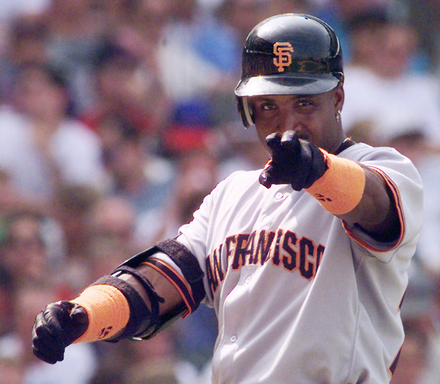. BARRY BONDS -- San Francisco Giants\' Barry Bonds signals to the crowd after hitting a home run in the fifth inning on Aug. 20, 1998 against the Chicago Cubs in Chicago. (AP Photo/Beth A. Keiser)