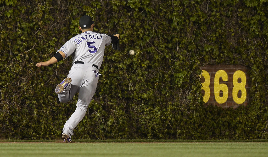 . Left fielder Carlos Gonzalez #5 of the Colorado Rockies cannot get to a leadoff double hit by Welington Castillo (not pictured) of the Chicago Cubs in the ninth inning on May 14, 2013 at Wrigley Field in Chicago, Illinois.  (Photo by Brian Kersey/Getty Images)