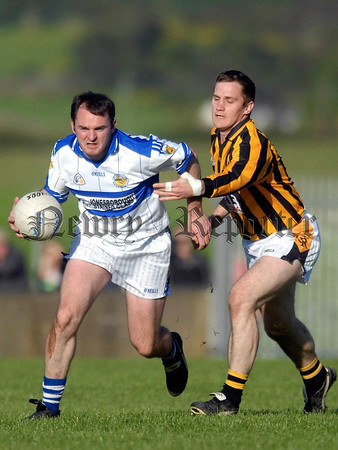 07W34N252 Armagh Senior Championship 2007 Second Round Crossmaglen Rangers v St Patricks Dromintee at Keeley Park Silverbridge. Dromintee's Aidan O Rourke and Crossmaglen's John McEntee.