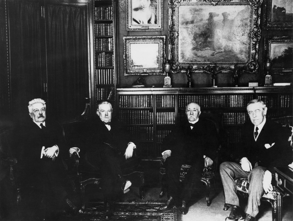 Description of . US President Woodrow Wilson, right, attends the Paris Peace Conference in 1919 where the League of Nations was born. Other members are from left to right: Italian Premier Vittorio Orlando, British Prime Minister David Lloyd George and French Premier Georges Clemenceau. (AP Photo)