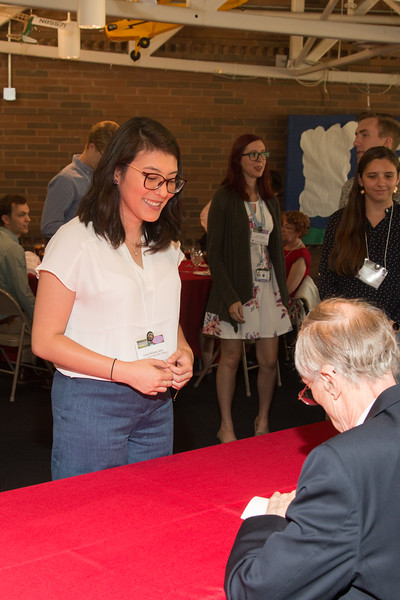 "Stela Ishitani Silva with John Mather, as he signs copies of his book ""The Very First Light"" -- An award luncheon, ""Dr. John Mather Nobel Scholars Program Award"", as part of the National Space Grant Foundation. College Park Aviation Museum, College Park, MD, August 2, 2019."