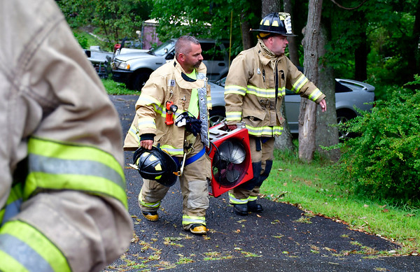 8/28/2019 Mike Orazzi | Staff Plymouth firefighters on scene of a shed fire on Main Street on Wednesday afternoon. No one was injured and fire was extinguished