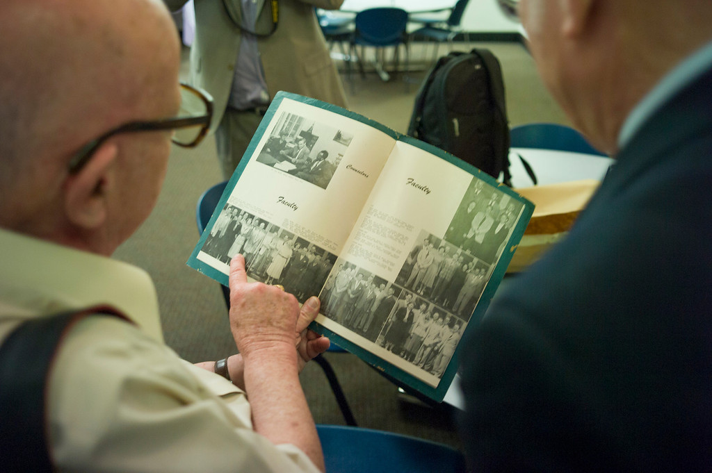 . LA Valley College\'s first student, Lloyd Jones, right, and fellow alumni Al Zucker, who has taught on campus for more than 50 years, look over the yearbook from 1949. Jones, a world renowned aviation artist was invited back to campus for a Deans reception.  Photo by David Crane/Los Angeles Daily News.