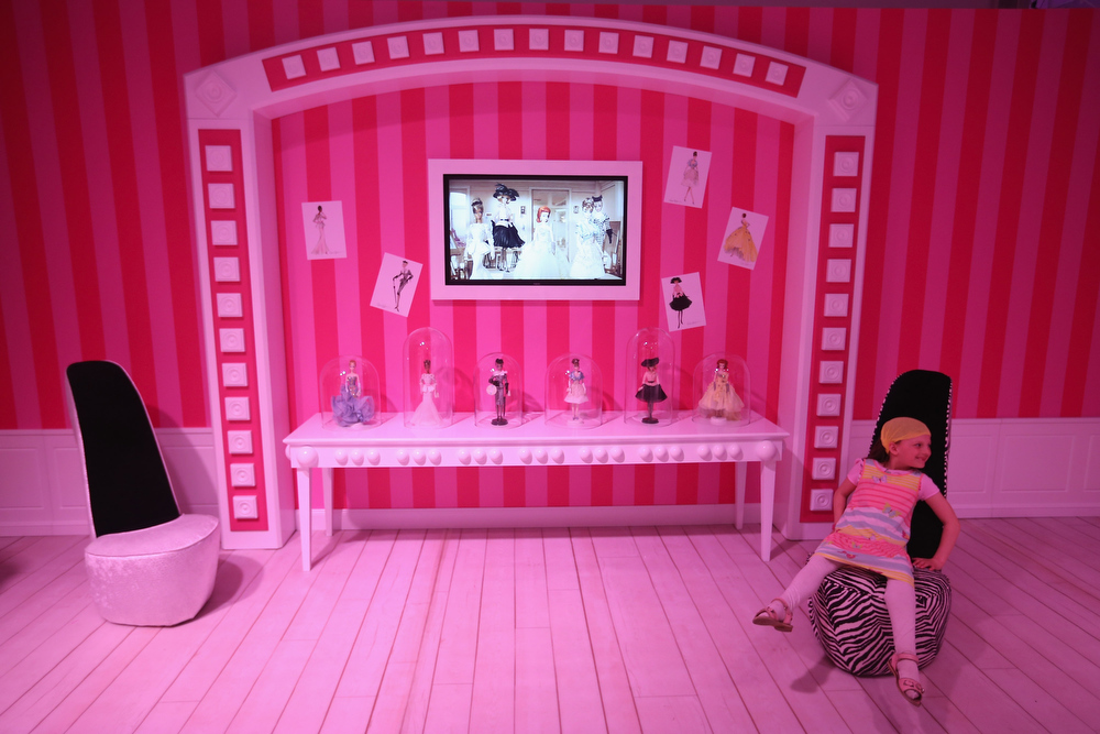. Amalie, 7, sits in a chair at the Barbie Dreamhouse Experience on May 16, 2013 in Berlin, Germany. The Barbie Dreamhouse is a life-sized house full of Barbie fashion, furniture and accessories and will be open to the public until August 25 before it moves on to other cities in Europe.  (Photo by Sean Gallup/Getty Images)