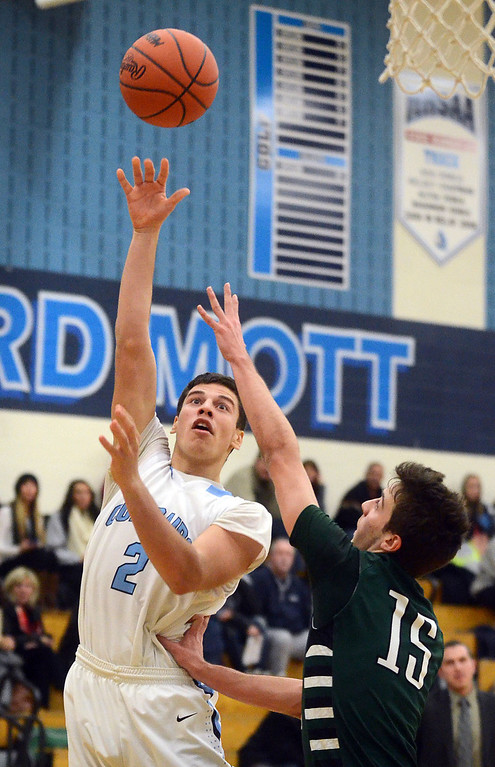 . Waterford Mott\'s #2 Elin Eugeniev shoots over West Bloomfield\'s #15 Anton Lucaj during their game at Waterford Mott High School, Thursday December 12, 2013. West Bloomfield went on to win the game 55-52. (Vaughn Gurganian-The Oakland Press)