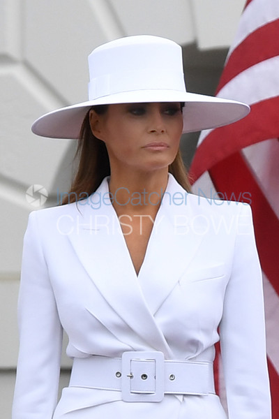 First Lady Melania Trump listens to her husband welcome President Macron of France to White House during Trumps' first Official State Arrival Ceremony.