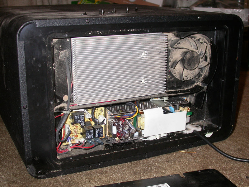 """Cheap Peltier wine cooler who's powersupply failed after less than 6 months of use.  With the plugs, top of case and about 1.5"""" from what was the plug end a mac LCII powersupply works as a great replacement."""