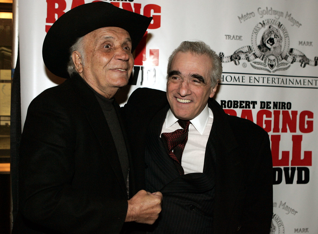 """. Boxer and author Jake LaMotta, left, fakes a punch to \""""Raging Bull\""""  filmmaker Martin Scorsese\'s gut for photographters before watching a 25th anniversary screening of the movie Thursday, Jan. 27, 2005 in New York. An anniversary collector\'s edition DVD of the film was also released.   (AP Photo/Julie Jacobson)"""