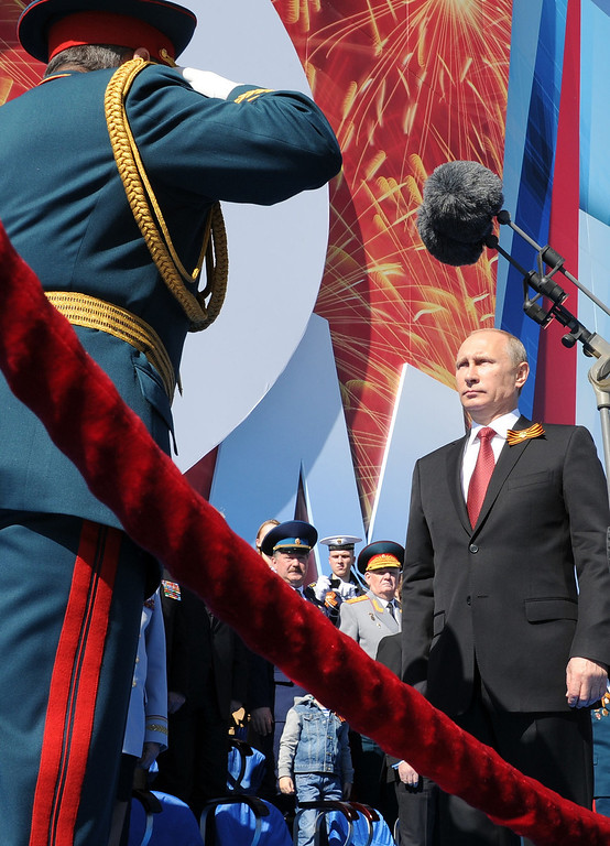 . Russia\'s President Vladimir Putin (R) attends a Victory Day parade at the Red Square in Moscow, on May  9, 2014. AFP PHOTO/ RIA-NOVOSTI/ POOL/ MIKHAIL  KLIMENTYEV/AFP/Getty Images