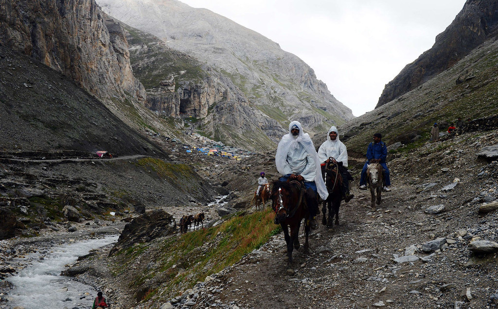 . Hindu devotees ride horses near Amarnath Cave on August 18, 2013. Every year, hundreds of thousands of pilgrims trek through treacherous mountains in revolt-torn Kashmir, along icy streams, glacier-fed lakes and frozen passes, to reach the Amarnath cave, located at an altitude of 3,857 meters (12,729 feet), where a Shiva Lingam, an ice stalagmite shaped as a phallus and symbolizing the Hindu God Shiva, stands for worship.   TAUSEEF MUSTAFA/AFP/Getty Images