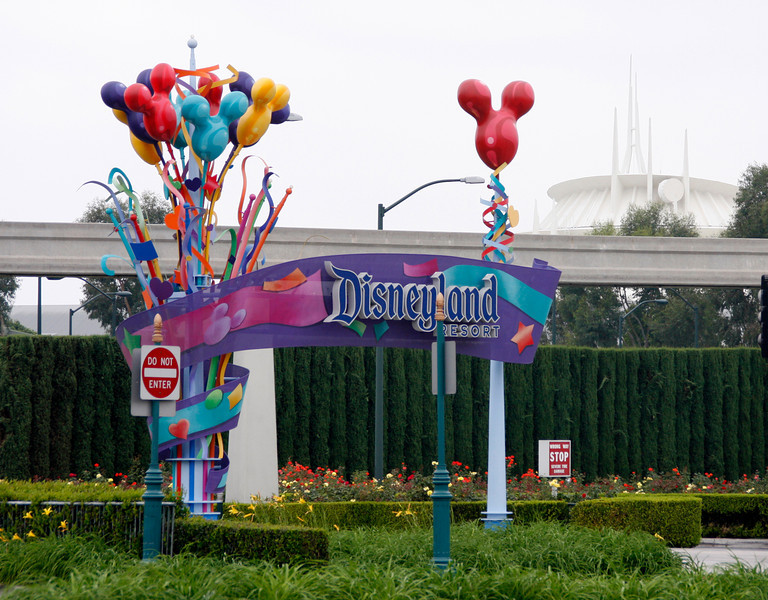 Disneyland entrance with Space Mountain hovering in the fog behind.