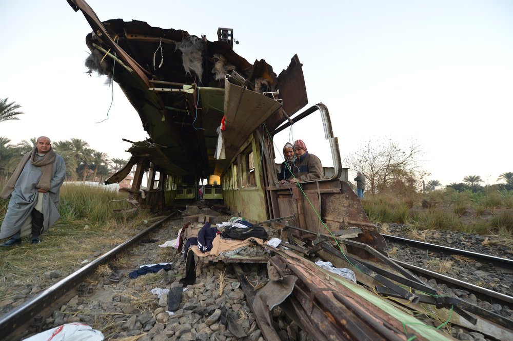 Description of . Egyptian workers remove the wreckage of a train in the Giza in Badrashin, about 40 km south of Cairo, on January 15, 2013, at least 19 people where killed and injured 105. The train carrying conscripts from south Egypt to Cairo derailed in the Giza neighbourhood of Badrasheen, state media reported. Giza governor Ali Abdelrahman said emergency services were at the scene and ambulances were ferrying the injured to hospital. The accident is the latest in a string of transport disasters plaguing the country.   KHALED DESOUKI/AFP/Getty Images