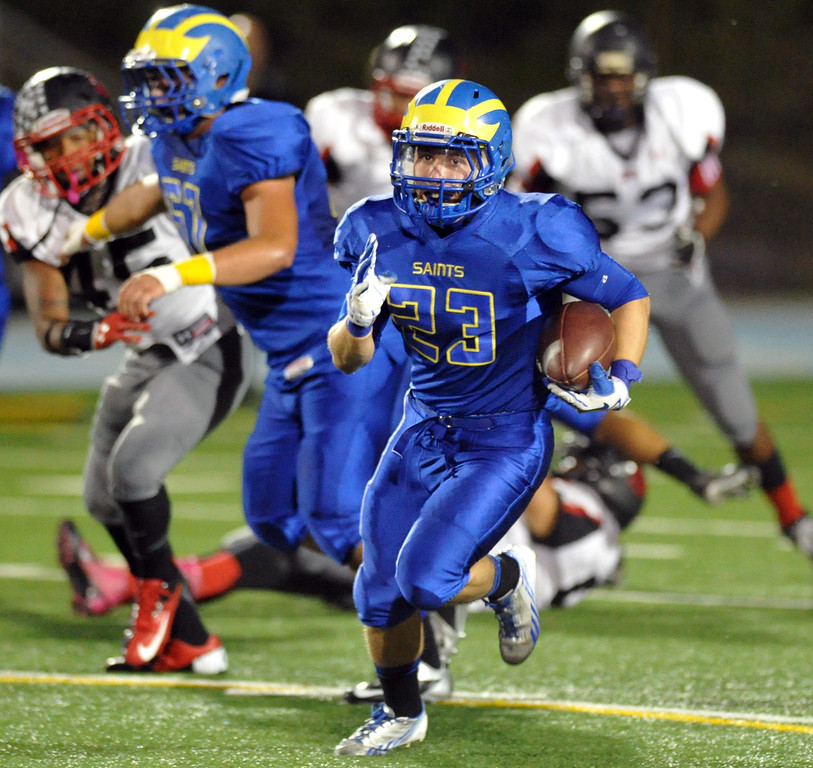 . San Dimas running back Joseph Mayorga runs for a touchdown as they play Pomona in their Valley Vista League football game at San Dimas High School on November 8, 2013. San Dimas defeated Pomona 49-6. (San Gabriel Valley Tribune/Staff Photo by Keith Durflinger)