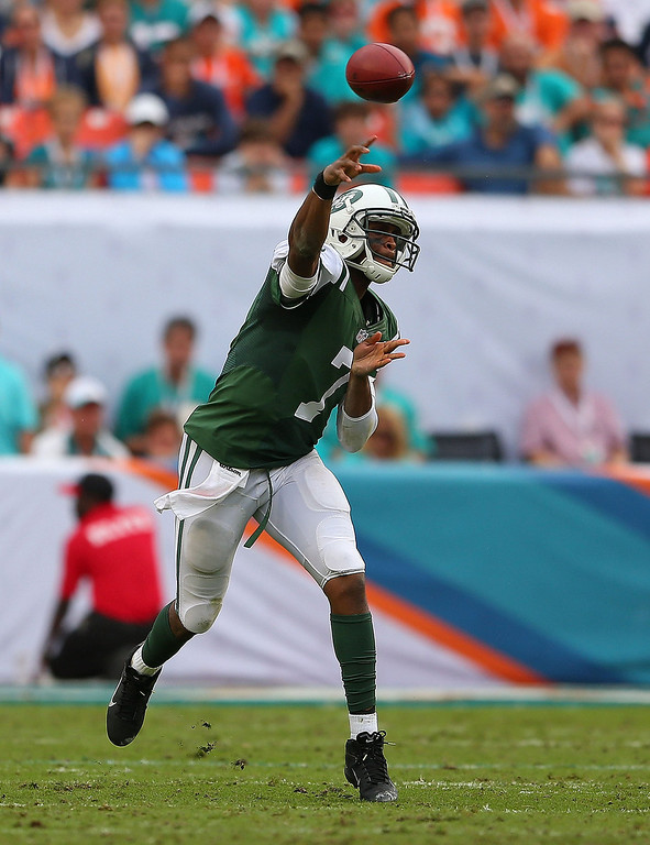 . Geno Smith #7 of the New York Jets passes during a game against the Miami Dolphins at Sun Life Stadium on December 29, 2013 in Miami Gardens, Florida.  (Photo by Mike Ehrmann/Getty Images)