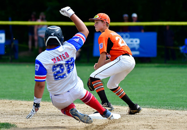 8/7/2019 Mike Orazzi | Staff Pennsylvania's Chase Deibler (26) as New York's Yady Mateo (28) slides into second during Wednesday's Eastern Regional Little League Baseball game at Breen Field in Bristol.
