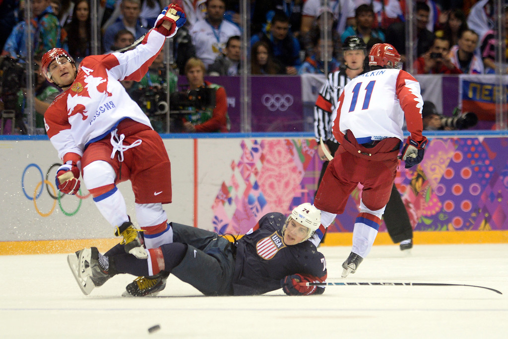 . SOCHI, RUSSIA - FEBRUARY 15: Alexander Ovechkin (8) of the Russia and T.J. Oshiet (74) of the U.S.A. collide during  the third period of the U.S.A.\'s shootout-win at Bolshoy arena. Sochi 2014 Winter Olympics on Saturday, February 15, 2014. (Photo by AAron Ontiveroz/The Denver Post)