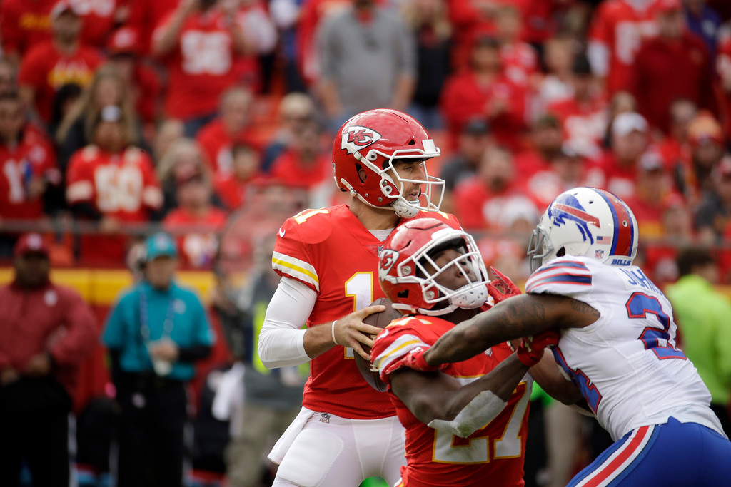 . Kansas City Chiefs quarterback Alex Smith (11) looks to pass as running back Kareem Hunt (27) blocks Buffalo Bills cornerback Leonard Johnson (24) during the first half of an NFL football game in Kansas City, Mo., Sunday, Nov. 26, 2017. (AP Photo/Charlie Riedel)