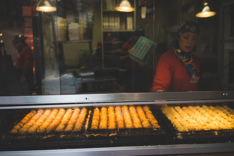 Photo Of A Woman Making Takoyaki In Osaka Japan