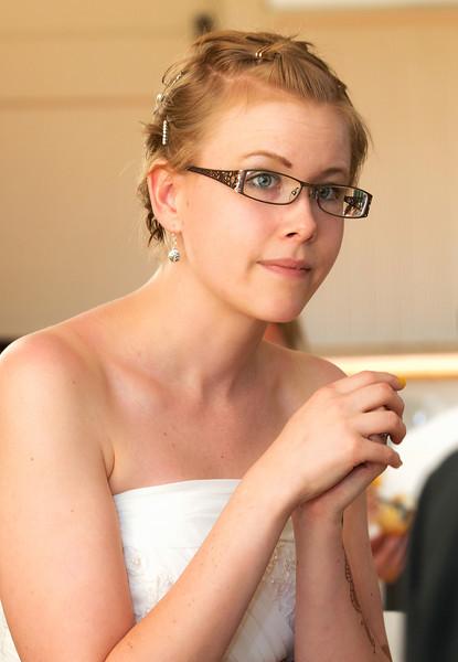Bride closeup candid listening to toasts.jpg