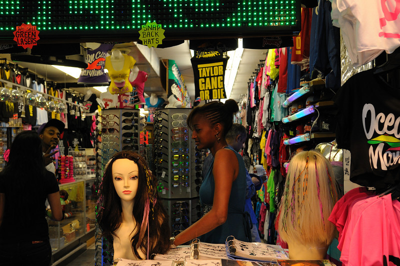 Girl in the front knows me but doesn't want her image captured, not so with the other clerk..........