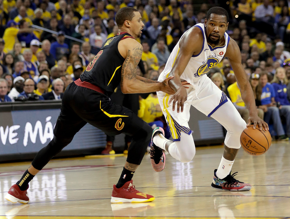 . Golden State Warriors forward Kevin Durant, right, drives against Cleveland Cavaliers guard George Hill during the first half of Game 1 of basketball\'s NBA Finals in Oakland, Calif., Thursday, May 31, 2018. (AP Photo/Marcio Jose Sanchez)