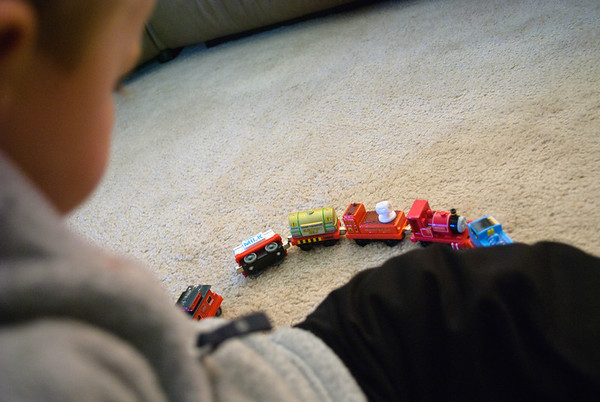 Sam playing trains