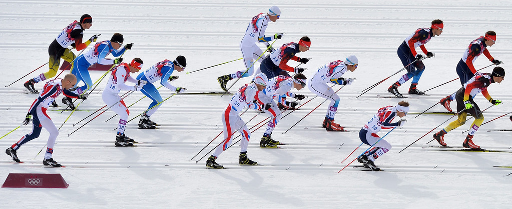 . Athletes in action during the Men\'s 15km + 15km Skiathlon competition in the Laura Cross Country Center at the Sochi 2014 Olympic Games, Krasnaya Polyana, Russia, 09 February 2014.  EPA/HENDRIK SCHMIDT