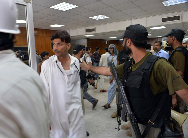 . Pakistani security personnel move supporters of Canadian cleric Tahir ul Qadri and cricket-turned politician Imran Khan from the headquarters of the state-owned Pakistani Television (PTV) after the building was stormed by demonstrators during anti-government protests in Islamabad on September 1, 2014. Hundreds of protesters trying to topple Pakistan\'s government stormed the state broadcaster on September 1 as fresh clashes with police broke out in Islamabad. AAMIR QURESHI/AFP/Getty Images