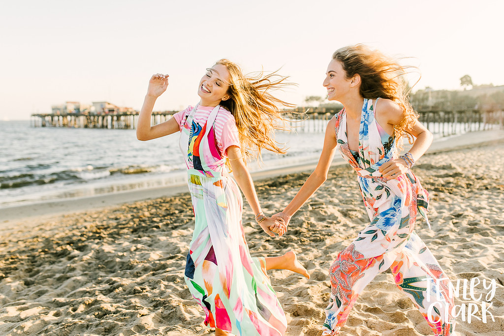 Tropical vacation themed teen fashion lifestyle best friends playful and colorful editorial shoot. Shot at Capitola Beach and Shadowbrook Restaurant. Photography by Tenley Clark. Styling: Jeneffer Jones. HMUA: Amy Lawson. Prop Styling: Lili Brumme