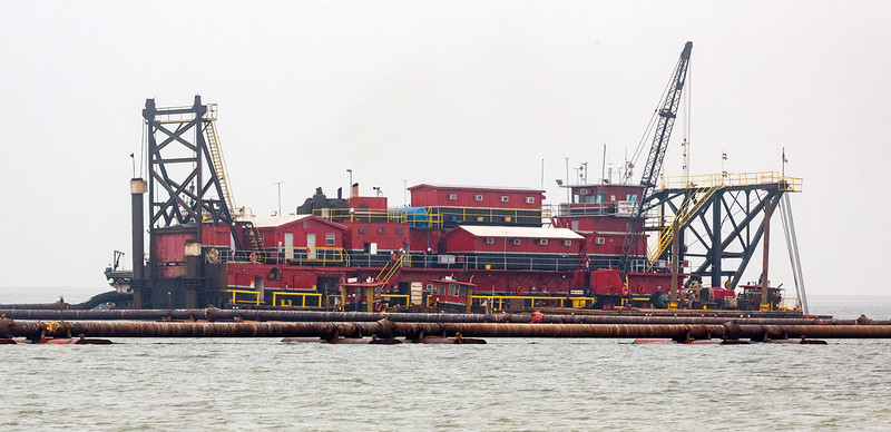 Huge floating dredge complex in channel leading to Texas City