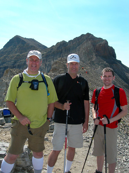 "2012-8-11 ––– One more hike up Timpanogos. This is number 11 and might be my last time. We are standing at the saddle getting ready to climb the last 800 feet to the 12,000 foot summit, which is the peak directly above my head. Then it is 9 long miles back down to the truck. We did the hike relatively fast this year, in 10 hours and 20 minutes. It was a beautiful day. You can see this location on the map from yesterday. It is clearly labeled as the ""Timp Saddle."""